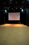 Studio/Lecture Theatre- seats away, 5 metre projection screen.